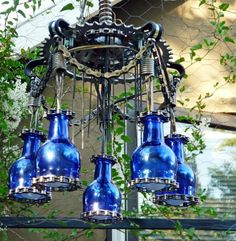 Exterior:Outstanding Outdoor Chandelier With Blue Glass Shades Plus Climbing Greenery Decor Plus Glass Window Design Beautiful Crystal and Candle Chandelier Lighting for Outdoor Dining Sets