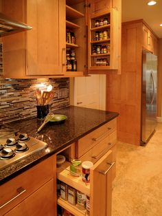 The spice rack attached to the cabinet door is a nice idea, but no sharp edges on the handles!  (enough bruises)  Like the cabinet design and color. Dark counter top looks good with this.  Like undercabinet lighting.  Don't like floor much.