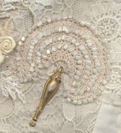 beaded lace fan - the CQ Mag links to the various meanings for fans