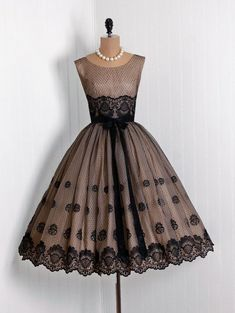 Scalloped lace edging, black beige 1950s party dress