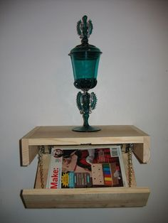Floating shelf with hidden storage compartment really nifty
