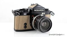 MIRANDA RE-II 35mm film camera with beautiful Natural Mahogany Wood inlay, and 50mm lens. Each unique piece of real natural wood is carefully planned and cut to size. Then, it is sanded to perfection and sometimes finished with a wood stain. Lastly, it is carefully hand placed into position. This vintage camera is clean and in good cosmetic condition. It is untested but all dials, knobs, and levers seem to work. The film advance lever works and sets the shutter, the shutter snaps, and the…