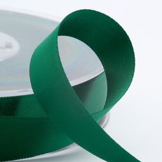 Trim your favour boxes with a rich luxurious colour when you use this Bottle Green Satin Ribbon