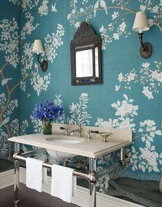 In Victoria Hagan's Connecticut home, Gracie wallpaper transforms the powder room into a garden.