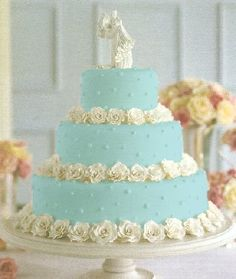 3 round tier Tiffany blue cake with white roses http://www.marketplaceweddings.com/blog/what-will-the-hottest-wedding-cake-trends-of-2014-be/