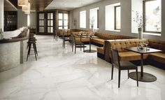 White Cararra Marble Tiles With No Maintenance Modern Spaces, Flooring, Stone Flooring, Marble Price, Sophisticated Tile, Wall Tiles, Fireplace Surrounds, Terrazzo Flooring, Fireplace Wall