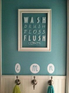 The picture was made with an old frame which I repainted and 3 different Cricut fonts in various sizes.  The hooks below are initialed for each of the kids towels and mounted above beadboard to prevent mildew from the wet towels.
