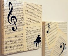 canvas covered with decades old sheet music, overlaid with musical symbols in black glitter. (This is cool for music room, but instead of ruining your sheet music, just copy pg and use tea bags to age; saves your original and gives same effect!)
