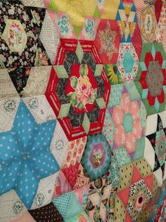 https://flic.kr/p/tmJLgh | Smitten Quilt Top | Hand stitching together rows of EPP hexagons to complete quilt top
