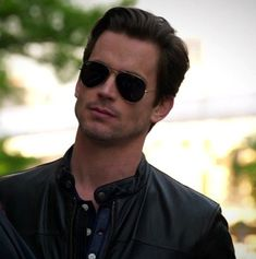 Leather jacket, Ray Ban aviators, breathtakingly gorgeous. Just offer Matt Bomer the role of Christian Grey already!!!