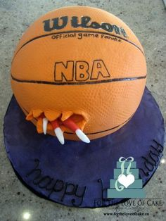 Toronto Raptor's basket ball cake - This basketball cake was made for a Toronto Raptors fan