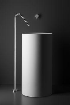 Single-hole freestanding pedestal lav faucet featuring unique swan-neck spout design with recessed aerator.