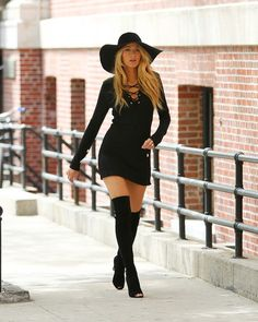 The actress wore a sexy little black dress, thigh-high peep-toe boots and a floppy hat for some of the shots. Description from starpulse.com. I searched for this on bing.com/images