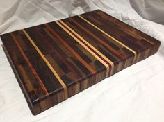 Our black walnut end grain multi-color cutting board.  Very cool!  It has mahogany, purple heart, maple and of course black walnut hardwoods. $150.00  #repurpose #upcycle #unique handcraft gifts