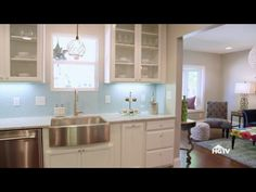 """Such a clean and spa like feeling kitchen from HGTV's show """"good bones"""". Sky blue hex penny tile backsplash"""