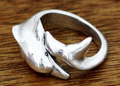 Leaping from the Balinese sea, a dolphin curls around the finger in a loving embrace in this #ring.