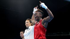 Great Britain's Nicola Adams celebrates victory over France's Sarah Ourahmoune…