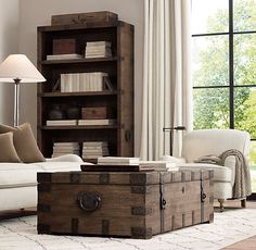 RH's Heirloom Silver-Chest Coffee Trunk:Drawing inspiration from an heirloom silver trunk, our authentic reproduction has been repurposed for use as a coffee table. Handcrafted of solid hardwood, it is accented with substantial hand-forged, hand-hammered iron hardware.
