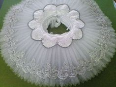 silver and white skirt decoration