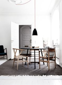 Mis-matched wood chairs, so much light, the subtle red chord, grays, neutrals.... love it all.