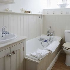Actual bathroom - tongue and groove showing bath panel and small shelf along top edge of full height panels. Continues behind the sink. And skirting board in bath panel Small Cottage Bathrooms, Cottage Bathroom Design Ideas, Coastal Bathrooms, Bathroom Design Small, Bathroom Ideas, Bathroom Designs, Bath Design, Wooden Bathroom, Family Bathroom