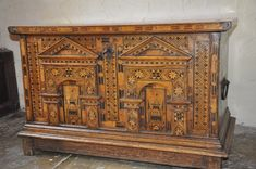 This is a rare 16th Century Nonsuch chest in remarkably original condition. The chest is of dovetail construction using highly figured oak all cleanly planed except for the underneath which has been left showing the original riving of the timber. The top is battened on the sides and front allowing the lid to fit over the chest itself. The top and ends are panelled out with a squared dark and light wood inlay enclosed in light stringing. The carrying handles are original except for one back…