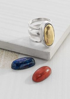 Primary Colors #Ring  R3266 | RETIRING Was $119.00  NOW $59.50 FAVORITES  This versatile Ring comes with three interchangeable oval stones in gold, red and blue tones, which allow you to customize your jewels based on your outfit (or mood) each day. The super-strong magnet and ingenious design will hold whichever stone you choose safely in place.  Material: Brass, Howlite, Larvikite