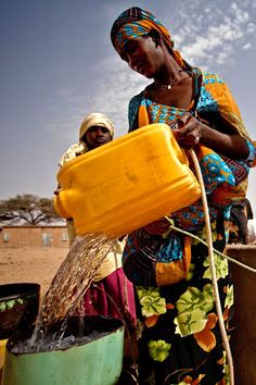 Mauritania - filling bucket with well water