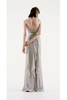 V-Neck Wrapped Bodice Dress with Satin Belt  $188.00 Style: VW360189 This V-neck wrapped bodice dress is timeless and romantic; perfect for your wedding party or any special occasion! Sleeveless V-neck wrapped bodice is adorned with an elegant satin belt. Long, soft chiffon skirt features cascading bias cut ruffles. Sizes 0-26. Fully lined. Back zipper. Imported chiffon. Dry clean only.