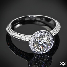 Beautifully crafted, this Custom 4 Prong Halo Diamond Engagement Ring is set in 18k White Gold and features a 0.910ct Round Center Diamond. The shank and halo hold 0.28ctw A CUT ABOVE® Hearts and Arrows Diamond Melee. -