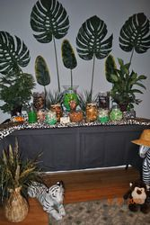 Wild Baby Shower  Baby Shower/Sip & See - safari baby boy shower - green balloons, whole fruit, hanging monkey, green/brown colors, jungle juice