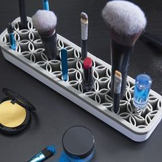 """Zen Cosmetics is a glamorous storage unit that's designed to hold onto your beauty essentials. The grippy silicone base accommodates primping tools of varying sizes, from brushes to pencils to tweezers. It'll keep you looking your best and your counters clutter free. Plastic. 8.3"""" L x 2"""" W x 1.3"""" H (210mm x 52mm X 34mm) Please allow 1 week for shipping."""