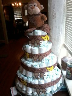 How to make a diaper cake...with step by step pics. Someday I will probably need to know how to do this.
