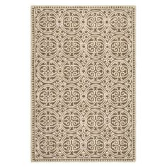 Anchor your living room seating group or define space in the den with this artfully hand-tufted wool rug, showcasing a geometric medallion motif for eye-catc...
