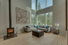 David Ward stick art piece for a Lake Tahoe Condo in a mountain modern setting of white walls and floors