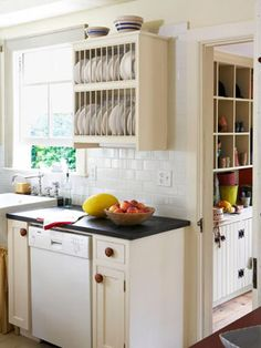 Give Dishes Room to Breathe  Instead of claustrophobia-inducing wall-to-wall cabinetry, this kitchen has two open upper storage units, including this plate rack. The lower cabinets, with solid doors, offer hidden storage.