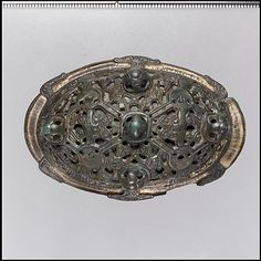 Oval Brooch, 10th century, made in Scandinavia, Viking, copper alloy, gilt.
