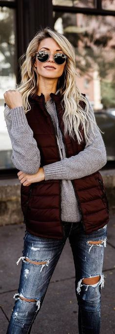 #fall #outfits sleeveless jacket grey sweater ripped jeans