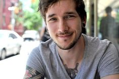 Tattoos, V-necks, stubble, moderate gauges, and a little nose piercing. Perfect!