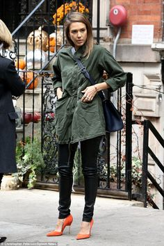 Dressing in the dark?Jessica Alba paired an army green jacket with black leather leggings...