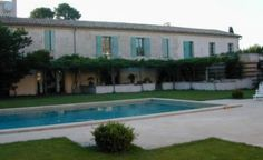 Nimes | Farmhouse | Languedoc Roussillon | Gard | South of France and the Riviera | Exclusive restored farmhouse in the heart of a marvelous orchard and a few minutes from Nimes. With large garden and private swimming pool | Sleeps 14 | #holidayrentals #frenchmaison #nimes #farmhouse #languedocroussillon #gard #southoffrance #riviera #pool #garden #holiday #france