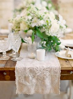 Like this look for spring - white flowers with green leaves, white lace runner, white china, crystal; would add clear votives, maybe shabby chic candelabra
