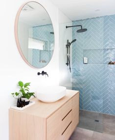 An updated, feminine bathroom idea. Herringbone shower tile in a peaceful aqua contrasts nicely with the round mirror and light wood vanity. So stylish! Laundry In Bathroom, Bathroom Renos, Bathroom Renovations, Small Bathroom, Bathroom Ideas, Bathroom Inspo, Feminine Bathroom, Guys Bathroom, Bathroom Plants