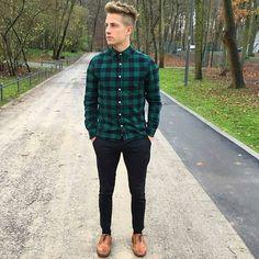 Green blue plaid shirt, black jeans, brown shoes
