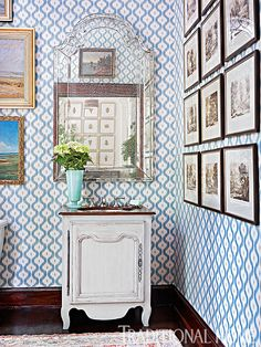 A watery-blue ikat enlivens the walls in the powder room. - Photo: Emily Jenkins Followill / Design: James Farmer