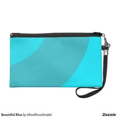 Beautiful Blue Wristlet Purse  Beautiful Blue wristlet is a really cute bag that will make a dramatic accessory to a lovely outfit. With lovely blue brush stroke design of two different hues of blue these colors complement each other perfectly. Shop Beautiful blue and other designs here at MissRhoadie1981. Tell a friend!  #Zazzle #MissRhoadie