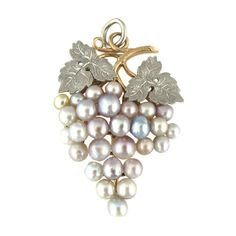 Victorian Bunch of Grapes Pearl Pendant. A platinum, rose gold and vari-coloured natural pearl pendant designed as a bunch of grapes with textured leaves.   Approximately 2cm width and 4cm height.   Continental marks. circa 1890s