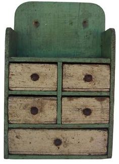"Late 19th century Wall Spice Cabinet, from New England, wonderful unclean surface with apple green case with cream painted drawers, nail construction, all original  Measures 6 1/4"" wide x 9 1/2"" tall x 3"" deep"