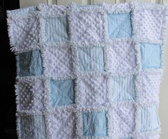 This sweet shabby rag baby quilt is a cute selection of different blues and white minky. They are all 100% cotton fabric. The center and back