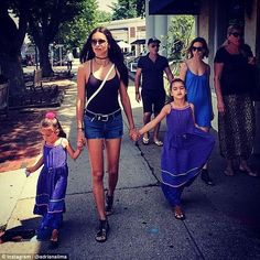 Doting mother: Adriana, who has two daughters, Valentina, seven, and Sienna, four, said her little girls are aware that 'mommy is a model'